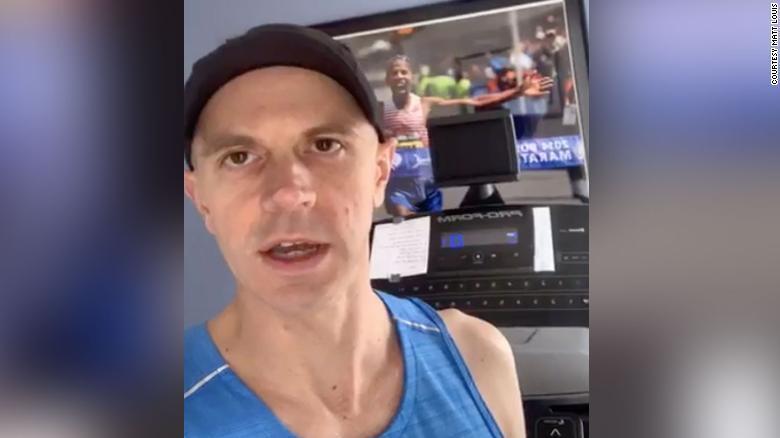 Matt Louis in front of his treadmill training station.
