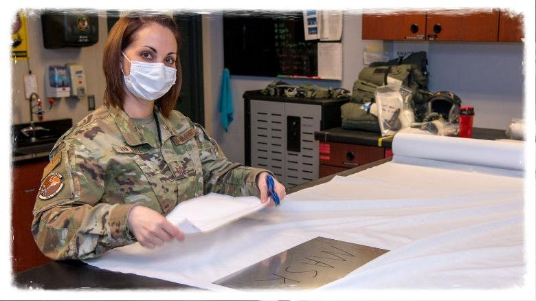 A member of the National Guard making masks.